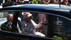 The Queen and Prince Philip arrive by car