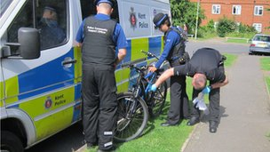Police during the operation in Ashford, Kent