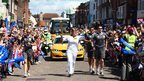Clare Balding with torch in Newbury