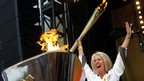 Caroline Burnett lights the cauldron with the Olympic Flame after the Torch Relay leg through Salisbury