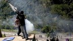 Coal miners fire a homemade rocket during clashes with the Spanish riot civil guard at the Pozo Santiago coal mine in Aller