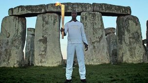 Michael Johnson with the Olympic flame at Stonehenge