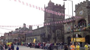 The crowds wait for the Olympic torch