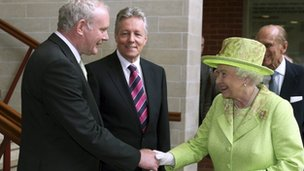 The Queen shakes hands with Northern Ireland Deputy First Minister Martin McGuinness, in Belfast, June 2012