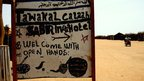 A sign for a cafe in Dadaab camp, Kenya