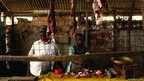 Mohamed Hassan Aden and his son in their butcher shop in Dadaab, Kenya