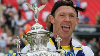 Micky Higham lifts the Challenge Cup trophy for Warrington