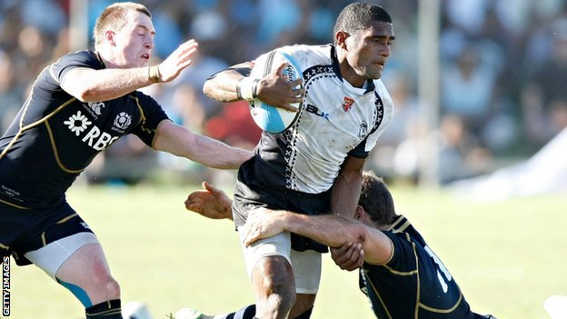 Nikola Matawalu (centre) in action against Scotland