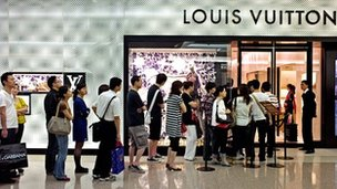 Chinese customers queue outside a Louis Vuitton store in Shanghai