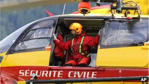 Rescue workers take-off to fly to the avalanche site in Chamonix, French Alps, Thursday, July, 12