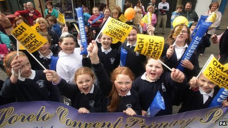 School children welcome the torch to Omagh