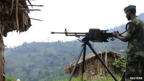 A M23 rebel fighter mans a machine gun at their defence position in Karambi, eastern Democratic Republic of Congo in north Kivu province, near the border with Uganda, 12 July 2012