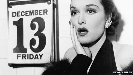 Young woman shocked at seeing Friday 13 on calendar