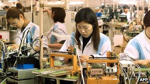Female workers of Japanese electronics giant Sony assembling parts