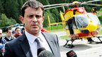 French Interior Minister Manuel Valls (C) answers journalists' questions on July 12