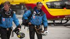 French rescue workers arrive at a helicopter landing area after an avalanche in the French Alps near Chamonix
