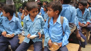 Nepalese children enjoy a school lunch