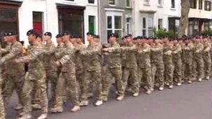 Soldiers from 1st The Queen's Dragoon Guards march through Swansea