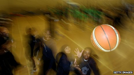 Youth club children plays basketball