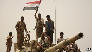 Yemeni army soldiers and tribesmen loyal to the army are seen on a tank in the city of Zinjibar. Photo: June 2012