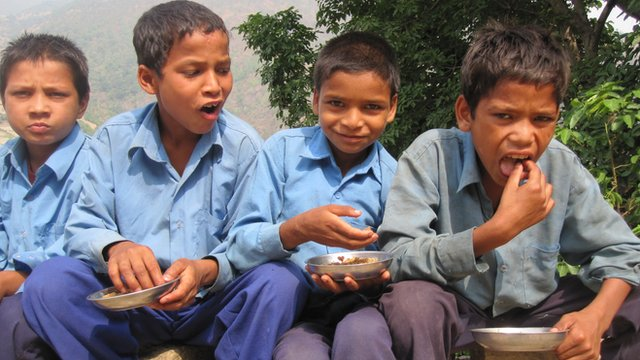 The power of school dinners - Nepalese pupils tuck in