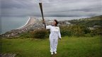 Vickie Mattock carried the Olympic flame on a hill overlooking Portland.