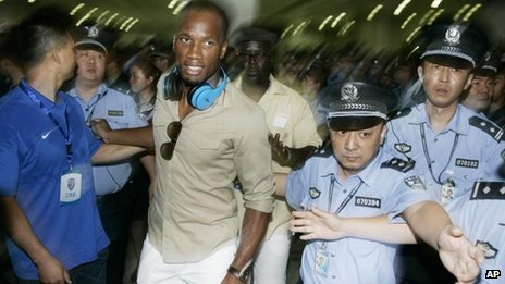 Didier Drogba arrives in Shanghai, 14 July