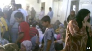 Image said to show relatives grieving in Tremseh, 13 July