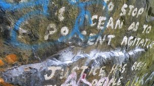 Text painted on a boulder