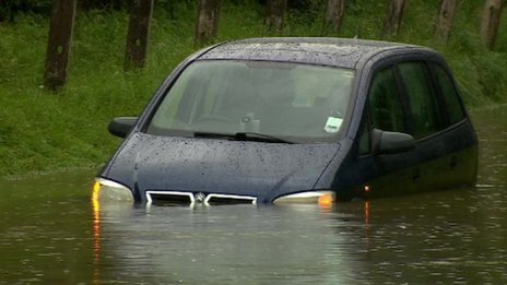 A car stuck in floods