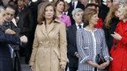 First Lady Valerie Trierweiler looks on from the reviewing stand on the Place de la Concorde in Paris before the start of the Bastille Day military parade, 14 July 2012.