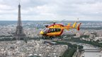 A civil defence helicopter flies over Paris on 14 July 2012 during the traditional Bastille Day military parade.
