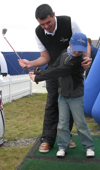 Mark Loftus coaches a young golfer at Castle Stuart