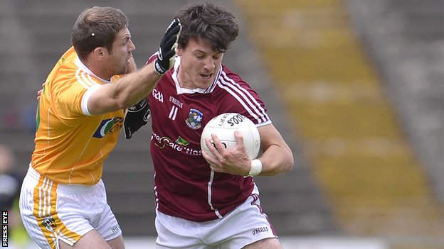 Antrim&#039;s Tony Scullion challenges Sean Armstrong of Galway