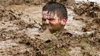 One man up to his neck in mud
