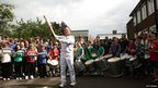 Torchbearer Stephen Baker and the Brockenhurst College Band