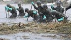 Japanese soldiers search for missing people in Aso,  Kumamoto prefecture, Japan.