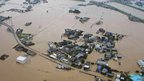 Aerial view of the flooded homes near Yabe River in Yanagawa, Fukuoka prefecture.