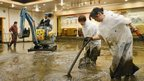 Workers clean a banquet room in Aso, Kumamoto prefecture.
