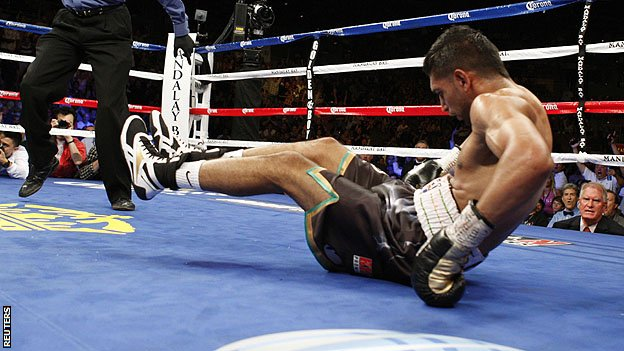 61578323 khan Amir Khan stopped in fourth round by Danny Garcia in Las Vegas