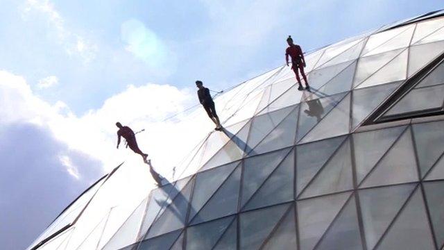 Dancers skywalk at City Hall