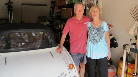 Mr and Mrs Russell with their Austin Healey in their Texas garage.