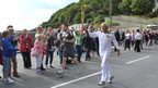 Roger Allsopp carries the Olympic torch in Guernsey