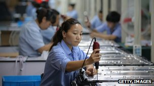 Workers assemble televisions on the production line at a factory in Shengzhou of Zhejiang Province, China, 03 July 2012