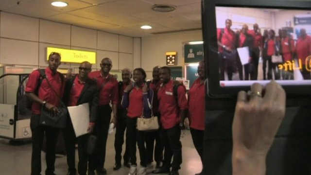 Olympic athletes pose for photo at Heathrow Airport