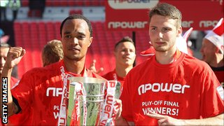 Byron Moore (l) and Nick Powell celebrate Crewe's League Two play-off final victory at Wembley in May