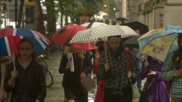 Shoppers with umbrellas