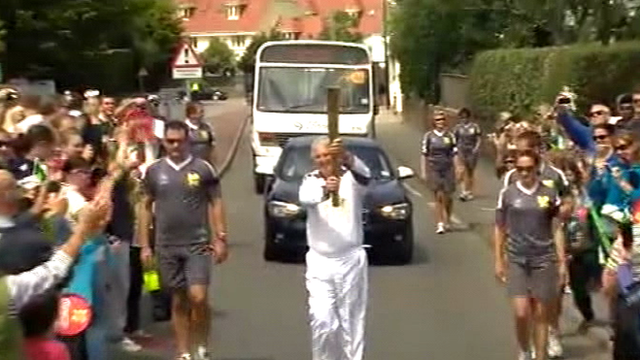 Richard Collinson carrying the Olympic Torch