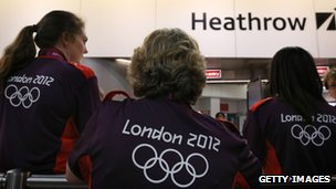 Volunteers waiting to greet arriving teams at Heathrow Airport in London