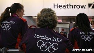 Volunteers waiting to greet arriving teams at Heathrow Airport in London